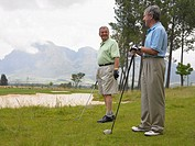 Senior men on golf course