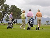 Golfers walking