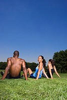 Joggers sitting on the grass