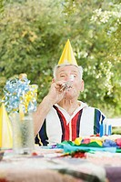 Senior man at a birthday party