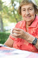 Senior adult woman drinking tea