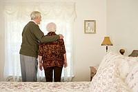 Elderly couple in their bedroom
