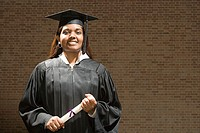 Female graduate holding her diploma