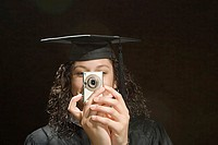 Female graduate taking a photograph (thumbnail)