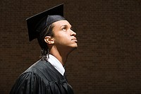 Male graduate looking up (thumbnail)