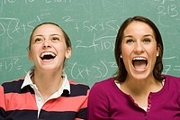 Two female students showing surprise