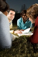 Four friends studying outdoors