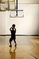 Man aiming for basketball hoop