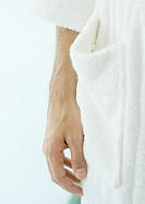 Close-up of man´s hand next to bathrobe