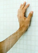 Man´s hand on shower wall