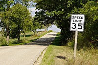 Wisconsin. Near Lake Geneva Speed Limit 35 sign along rural country road, small hill, trees along lane
