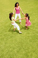 Mother and daughters playing