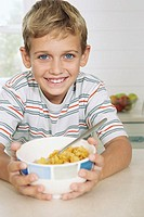 Young boy with a bowl of cereal