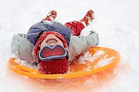 Boy lying on a sled