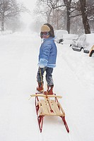 Girl pulling a sled