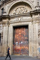 Grafittied door of a bank. Buenos Aires, Argentina