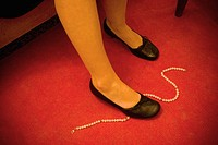 Necklace on carpet