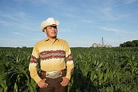 Cowboy in farm field (thumbnail)