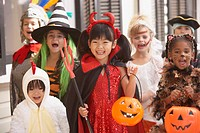 Group of children dressed up in costumes for Halloween