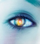 Close-up of a young woman's eye and skin covered in binary code