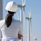 Female engineer examining wind turbines (thumbnail)