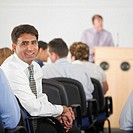 Businessman smiling in conference
