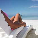 Young woman sunbathing on the beach (thumbnail)