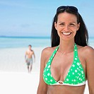 Woman smiling at the beach