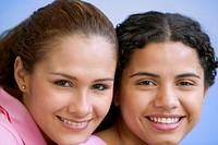 Close up portrait of two teenage girls smiling