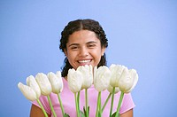 Portrait of teenage girl with tulips