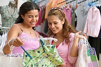 Two teenage girls shopping for clothes