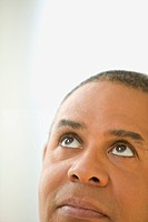 Close up of mature man looking up