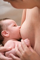 Mother breast feeding her baby