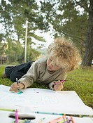 Young girl drawing outside