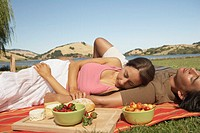 Couple sleeping during a picnic