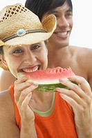 Young woman eating a watermelon