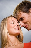 Close-up of a teenage couple smiling at each other (thumbnail)