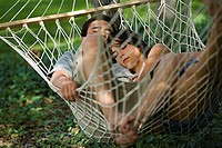 High angle view of a young couple relaxing in a hammock (thumbnail)