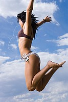 Profile of a young woman jumping in air (thumbnail)