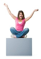 Portrait of a teenage girl sitting on a blank sign (thumbnail)