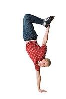 Portrait of a young man doing one handed handstand (thumbnail)