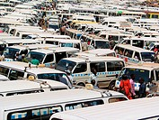 An ocean of mini-buses serve the people of downtown Kampala, Uganda during the rush hour. Actually the rush hour is the whole day and most of the even...