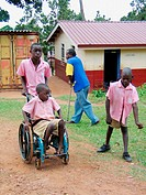 Students change classes at the Kampala School for the Physically Handicapped, Uganda. The school is financed privately through donations from Ugandans...