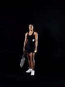 Mature woman holding tennis ball and tennis racket, portrait