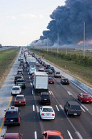 Traffic caused by brush fire on highway, rear view