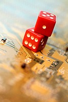 Close-up of two dice on a circuit board