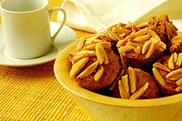 Close-up of almond muffins in a bowl (thumbnail)