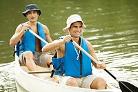 High angle view of two mid adult men boating in a river