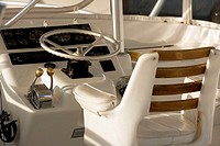 Close-up of the steering wheel of a boat