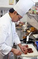 Cutting dry pimientos choriceros, Luis Irizar Cooking School, Donostia, San Sebastian, Gipuzkoa, Euskadi. Spain.